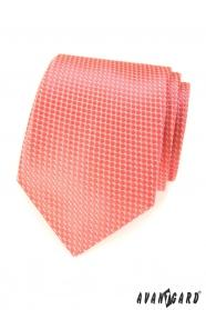 Krawat w kolorze łososiowym z regularnym wzorem