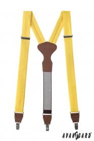 Żółte szelki z brązowa skóra i metalowym zapięciem